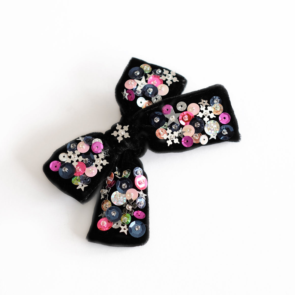 Black velvet hair bow with sequin.