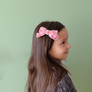 Model with pink sequin velvet bow.