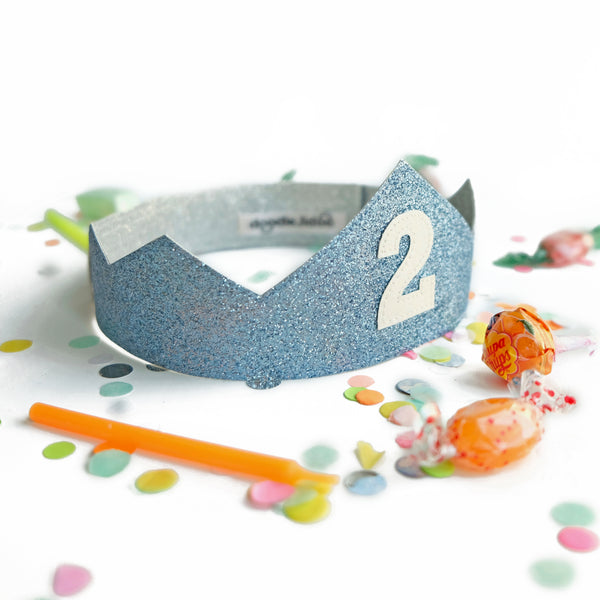 Personalized birthday crown in blue and silver glitter.