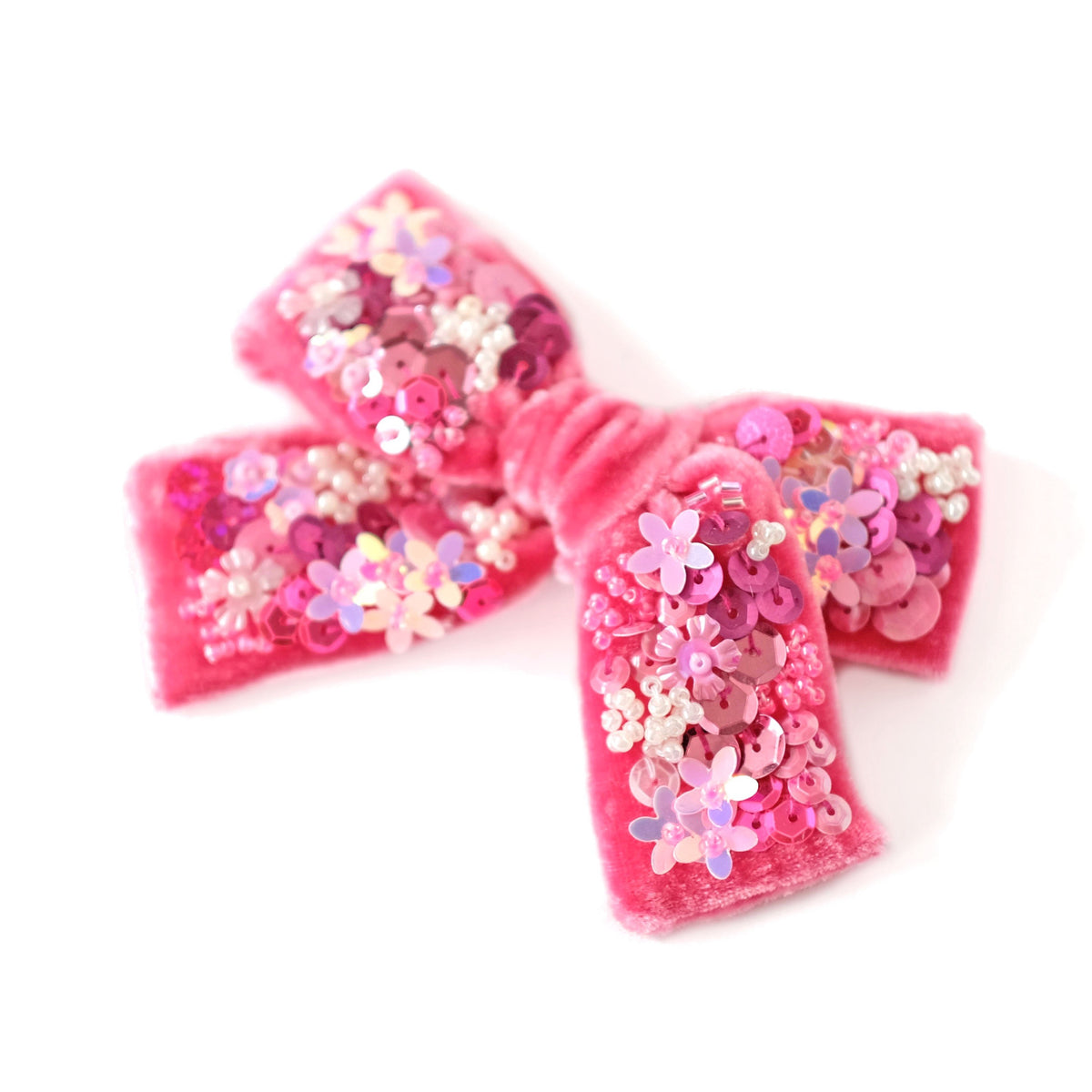Pink velvet hair bow with sequins.