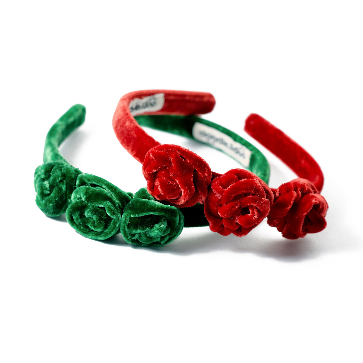 Velvet headbands with rosebuds in red and green.