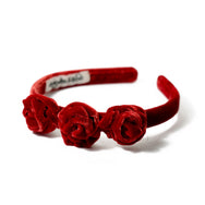 Red velvet headband with rosebuds.