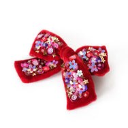 Red velvet hair bow with sequin.