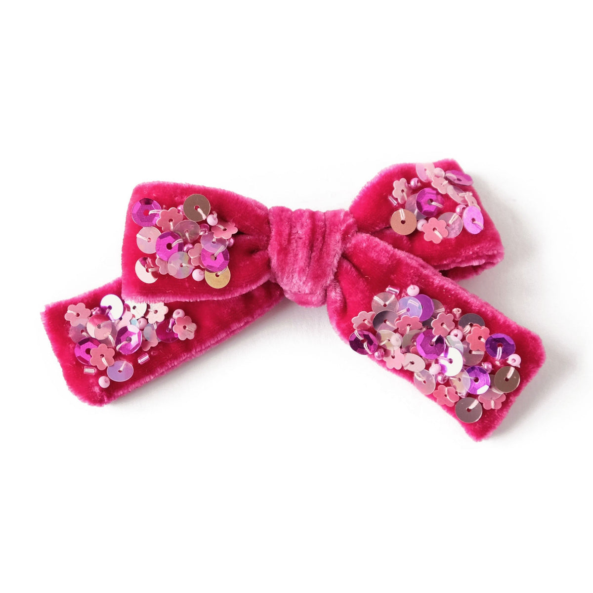 Silk velvet hair bow with sequin in pomegranate pink.