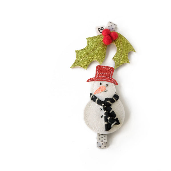 Frosty the Snowman and holly hair clips.
