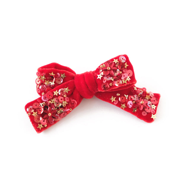 Velvet hair bow in cherry red, medium sized.