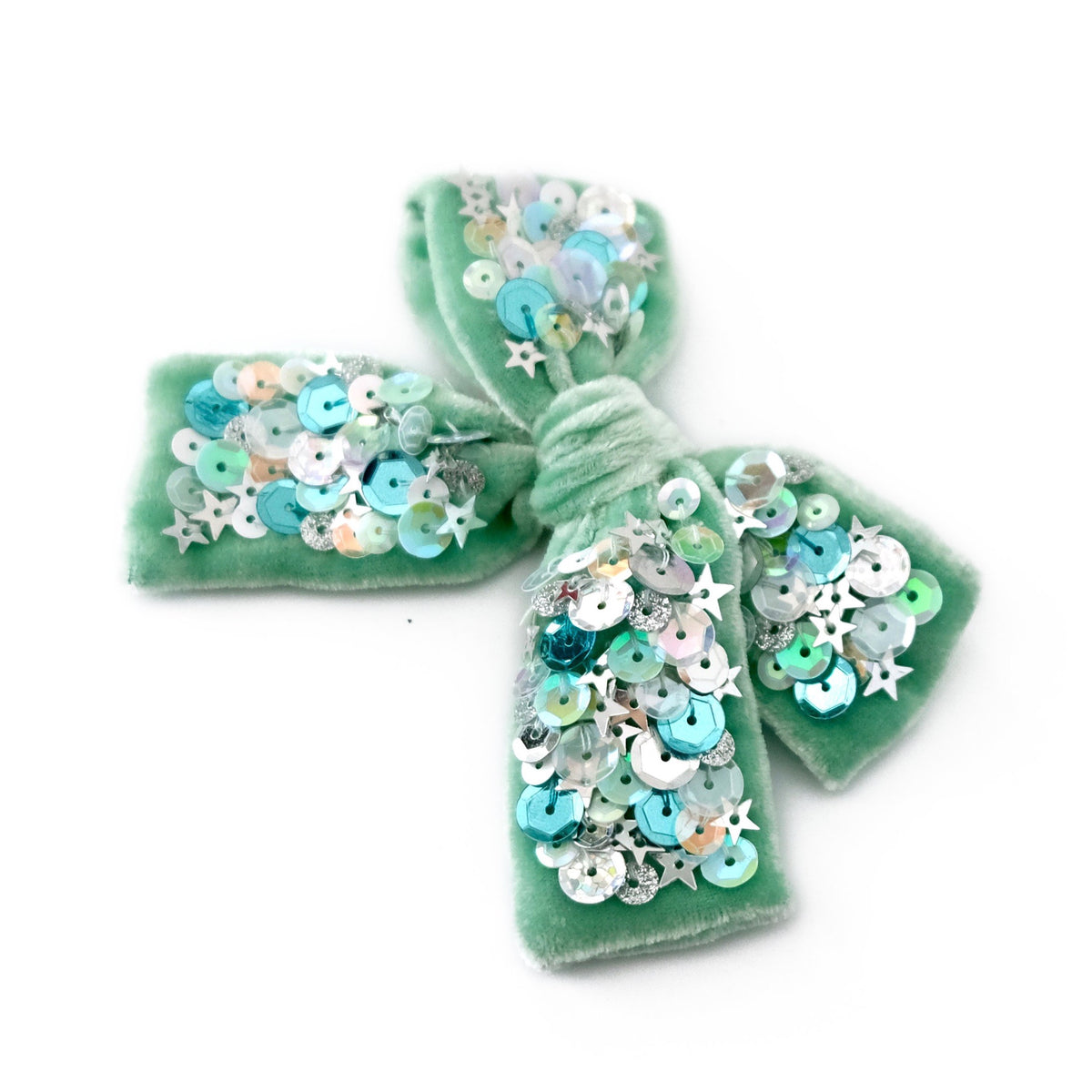 Velvet hair bow with sequin in mint green color.