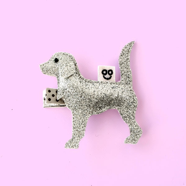 dog hair clip in silver on purple background