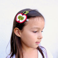 girl wearing apple hair clip