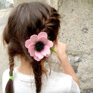 girl with braids and pink flower