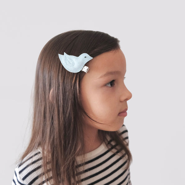 girl with chickadee hair clip in her hair