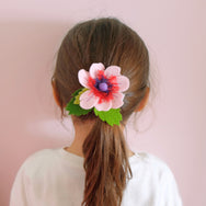 girl with felt flower pony tail