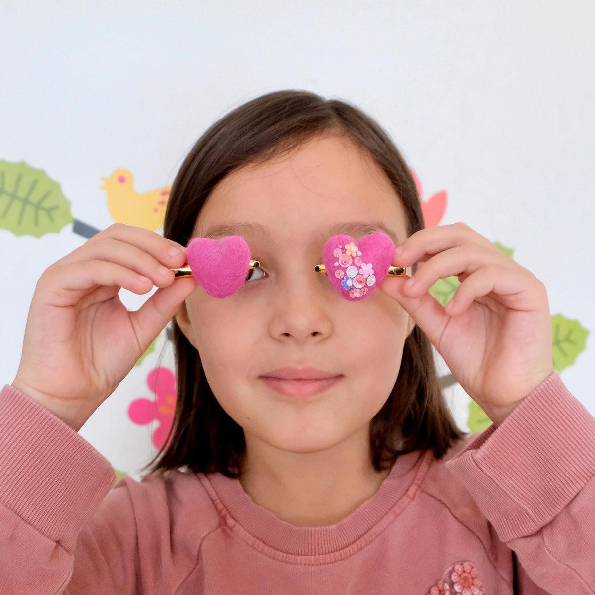 Girl with heart hair clips