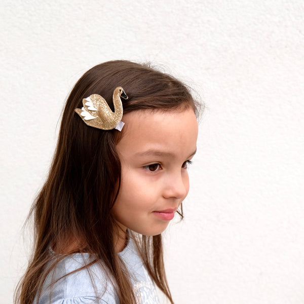 girl with swan hair clip