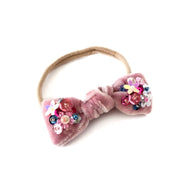 Baby hair bow headband in velvet with sequin.