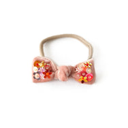 Hair bow with sequin, baby headband, in peach colored velvet.