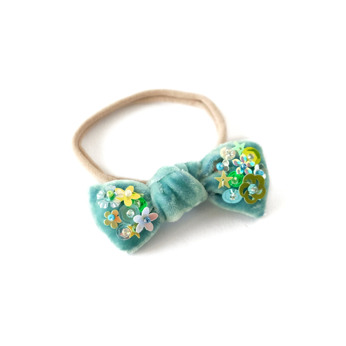 Hair bow with sequin mounted onto a baby headband, in titan green velvet.