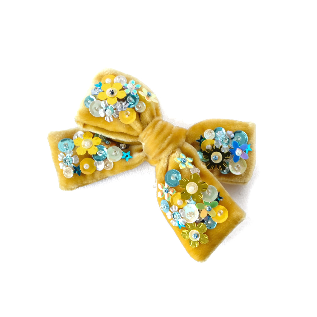 Hair bow with sequin, medium size, in honey yellow colored velvet.