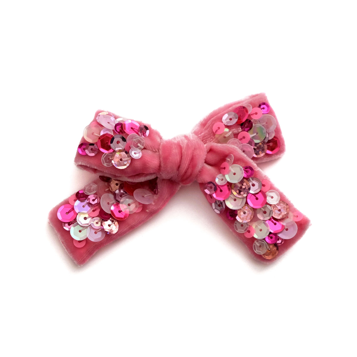 Velvet hair bow with sequin in pink.