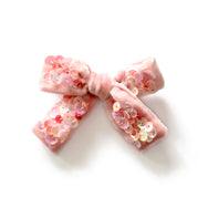 Velvet bow in pink seashell color.