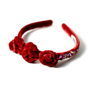 Red velvet headband with sequin.