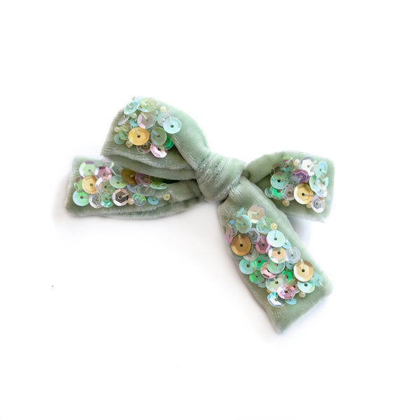 Velvet hair bow in sea foam green.