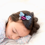 Sleeping girl with bee clip.