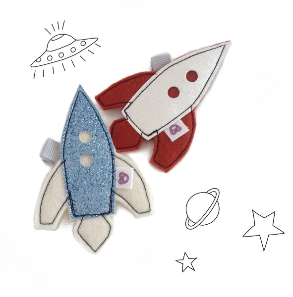 spaceship hair clips in blue and white
