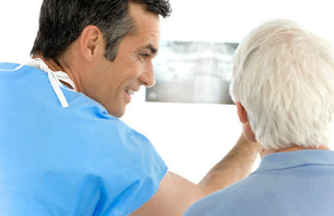 Dentist Working With a Senior
