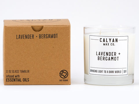 Lavender Soy candle with cardboard box on a table