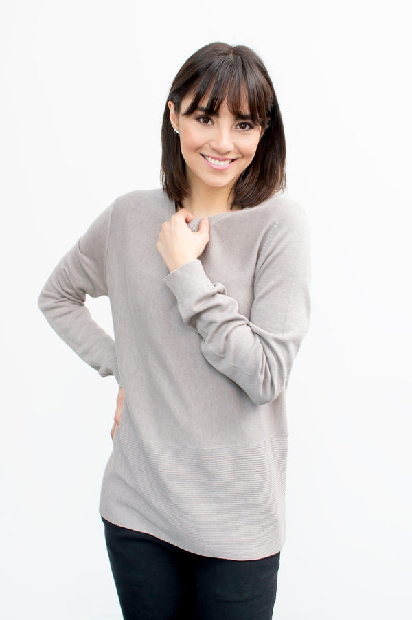 Girl wearing taupe crew neck sweater