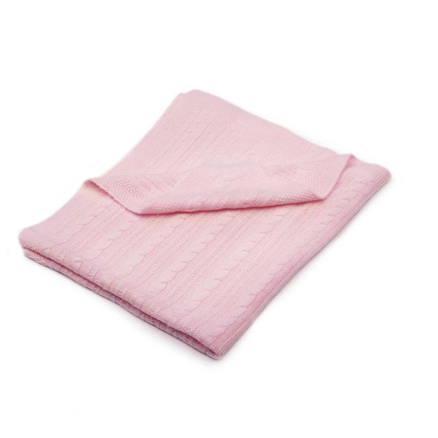 Folded pink cable-knit blanket for travelling with babies on strollers, carriers and car seats