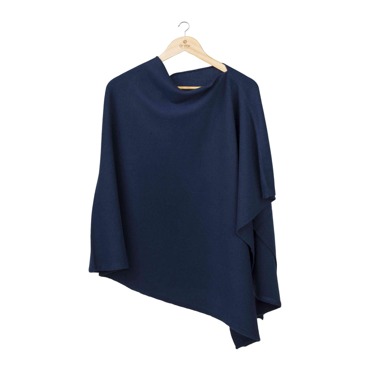 Poncho wrap for girls and women in blue on a clothes hanger on a white background