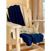 Grete throw in blue over chair