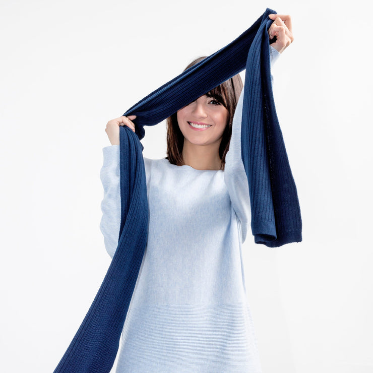 model extending blue scarf by grete over her face