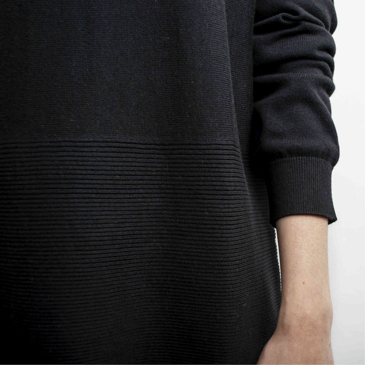 folded sleeves of black ribbed crew neck sweater by grete
