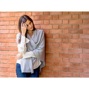 model wearing grey poncho wrap by grete