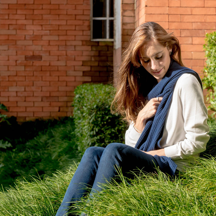 model sitting on the grass wearing blue scarf by grete