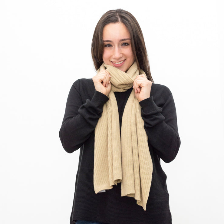 model wearing black crew neck sweater with beige scarf by grete