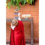 kid grabbing a cupcake wrapped around in red Throw Grete