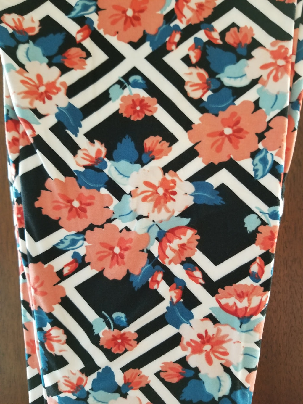 PS Black/White background w/peach floral blue leaves