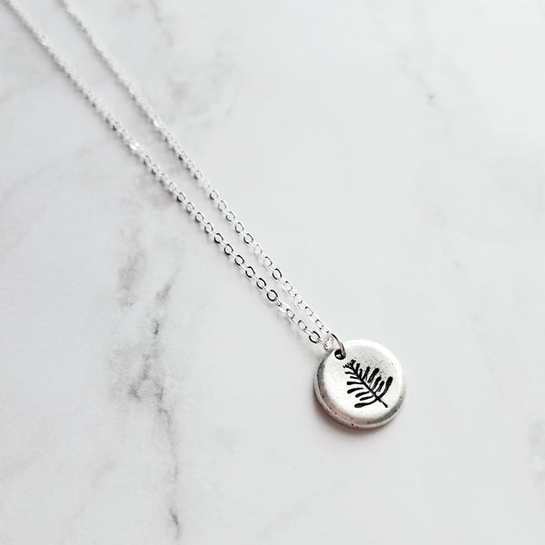 Leaf Pendant Necklace - simple little fern stamp on small thick antiqued pewter finish round disk pendant - sterling silver plated delicate adjustable chain