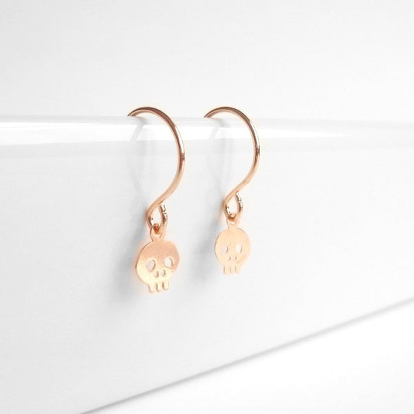 Pink Skull Earrings - rose gold little skeleton micro minis - delicate simple minimalist bitty style on teeny tiny petite dainty hooks