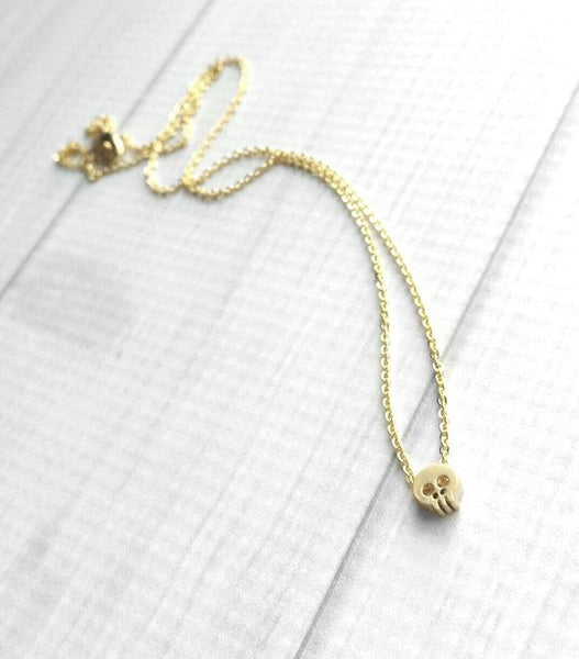 Small Skull Necklace - gold tiny pendant slider on delicate chain - Halloween spooky fall autumn accessory charm - little goth skeleton