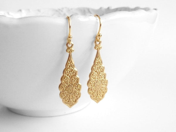 Long Gold Earrings - brass elongated teardrops with intricate stamped Moroccan scroll design and scalloped edges on simple little ball hooks