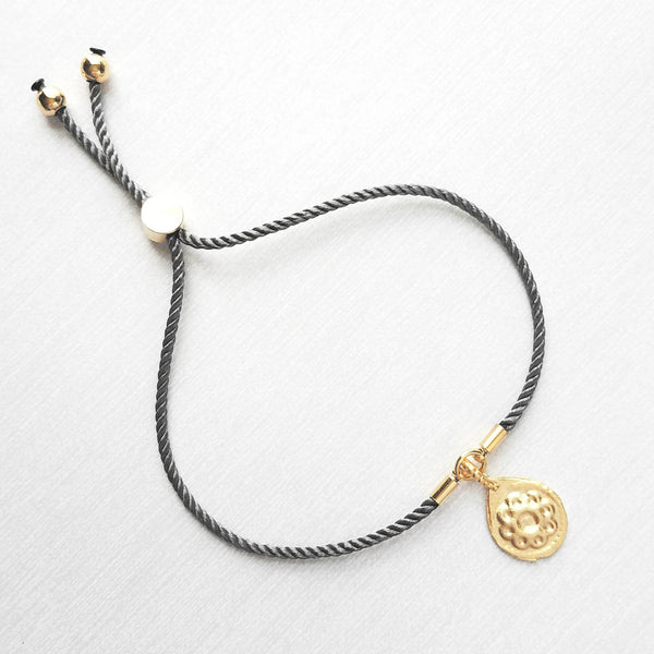 Gold Charm Bracelet - grey silk style twisted thin cord - flower medallion accent adjustable bead - one size fits most - stacking layer gray