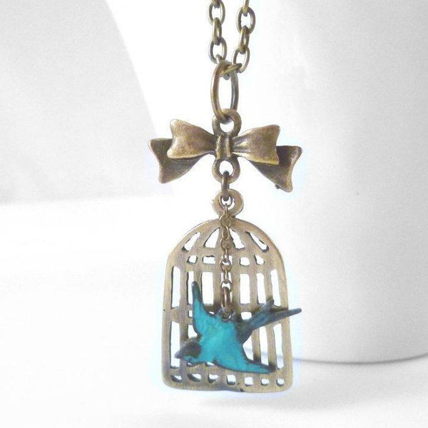 Birdcage Necklace - antique brass bird cage pendant / little bronze bow - free flying small aqua sparrow - oval link chain - Escape Flight - Constant Baubling