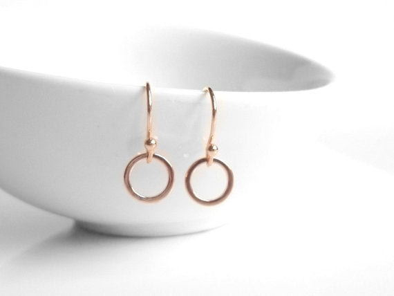 Rose Gold Circle Earrings - tiny little simple hoops dangle from small pink rose gold plated ear hooks - minimalist delicate lightweight
