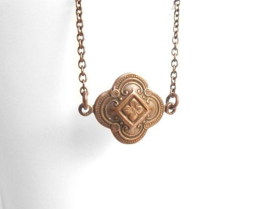 Copper Clover Necklace - little antiqued 4 leaf clover on a delicate copper plated chain - delicate detailed stamping in red brown rust