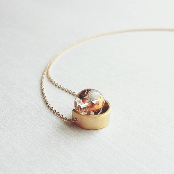 Eclipse Necklace - gold over clear glass orb in semicircle brass spinner - mottled sparkling splotchy sphere ball - unique celestial gift